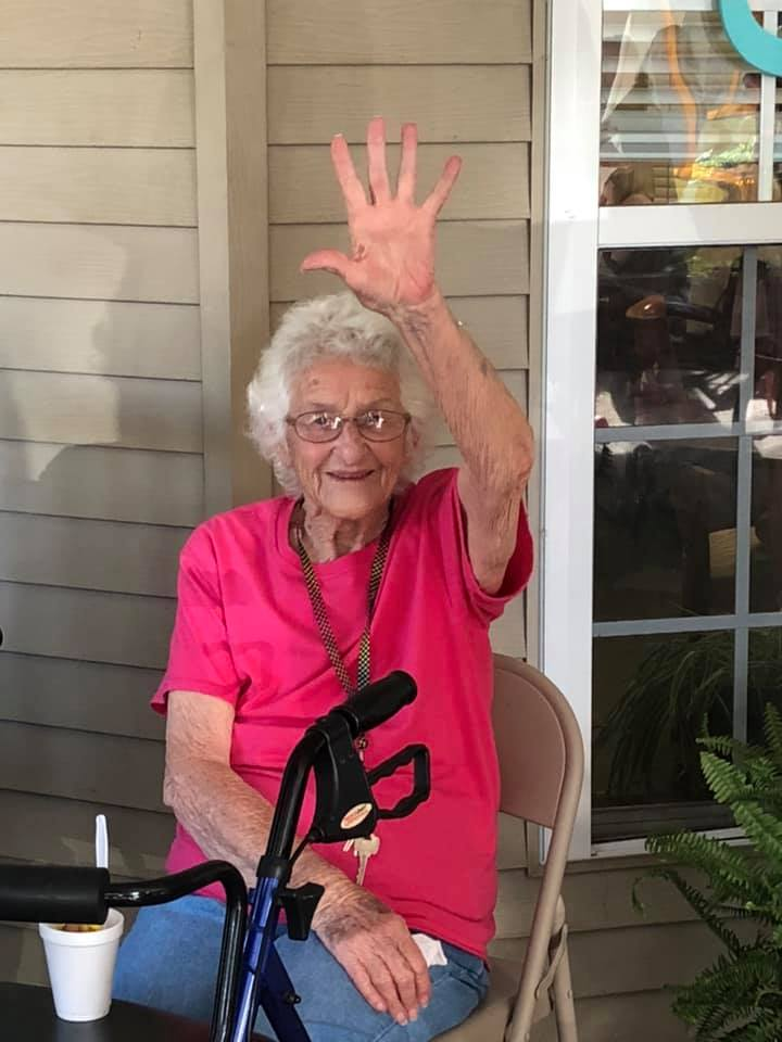 Resident waves hello from Somerset Court of Cherryville